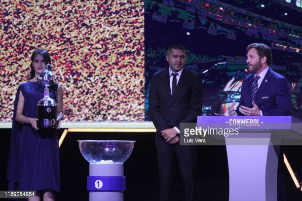 President of CONMEBOL Alejandro Dominguez speaks before delivering a Copa Libertadores Trophy replica to former player and current second Vice...