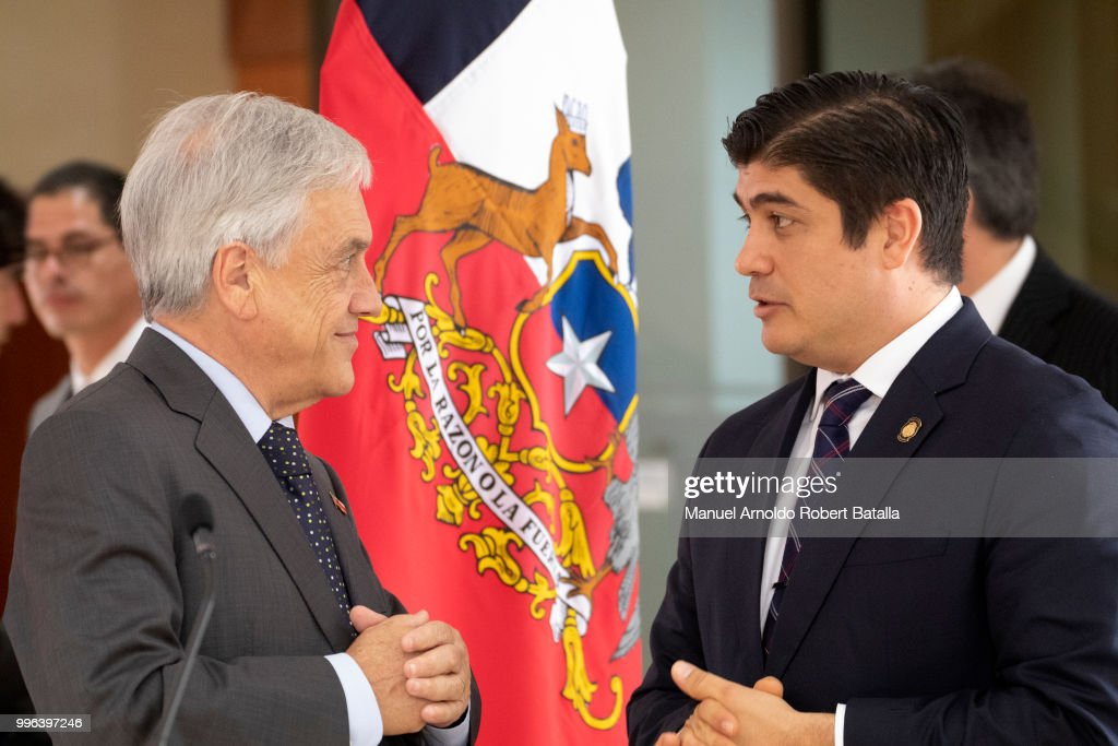 President of Costa Rica Carlos Alvarado and President of Chile Sebastian Pinera talk prior a press conference as part of an Official Visit to Costa Rica at the Presidential House on July 9, 2018 in San Jose, Costa Rica.