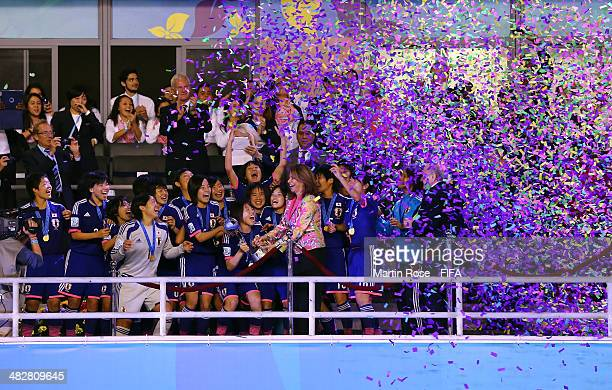 President of Costa Rica Laura Chinchilla Miranda hands over the trophy to Hina Sugita of Japan after the FIFA U17 Women's World Cup 2014 final match...