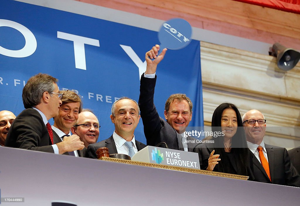 President of Coty Beauty Renato Semerari, Coty SVP of Human Resources Geraud-Marie Lacassagne, Coty CEO Michele Scannavini, President of Coty Prestige Jean Mortier, designer Vera Wang and Coty SVP Jules Kaufman ring the opening bell at the New York Stock Exchange on June 13, 2013 in New York City. Global beauty company Coty made its public debut today.