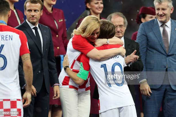 President of Croatia Kolinda Grabar Kitarovic greets Luka Modric of Croatia as he is presented with his runnersup medal after the 2018 FIFA World Cup...