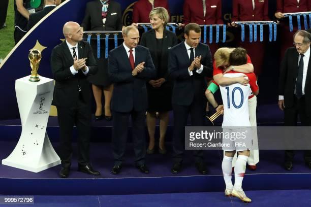 President of Croatia Kolinda Grabar Kitarovic greets Luka Modric of Croatia as he is presented with his runnersup medal after the 2018 FIFA World Cup...