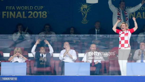 President of Croatia Kolinda GrabarKitarovic celebrates the first goal for Croatia while President of France Emmanuel Macron his wife Brigitte Macron...