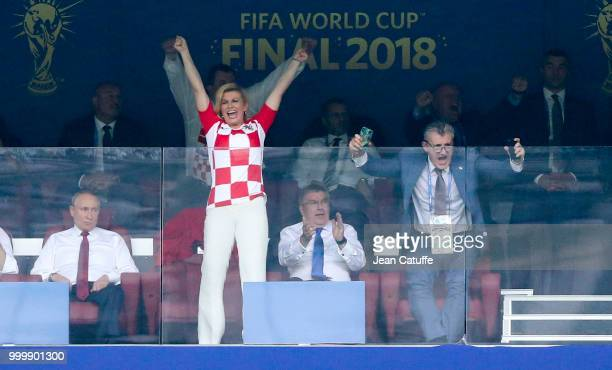 President of Croatia Kolinda GrabarKitarovic celebrates the first goal for Croatia with President of Croatian Football Federation Davor Suker while...