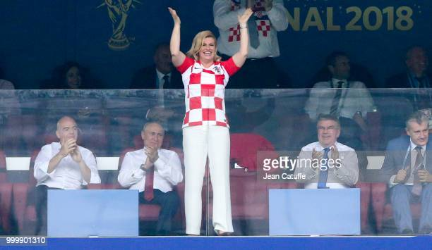 President of Croatia Kolinda GrabarKitarovic celebrates the first goal for Croatia while FIFA President Gianni Infantino President of Russia Vladimir...
