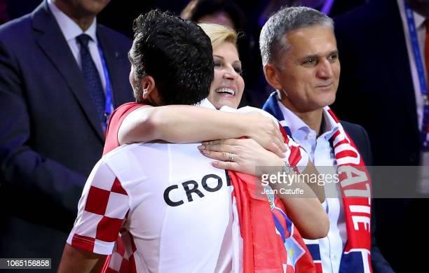 President of Croatia Kolinda GrabarKitarovic greets Marin Cilic of Croatia after he wins his single and the Davis Cup during day 3 of the 2018 Davis...