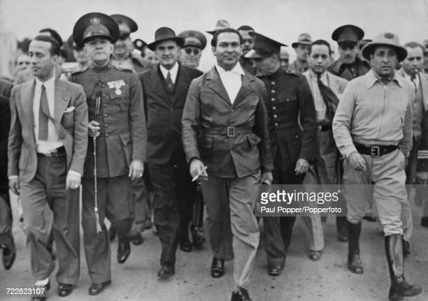 President of Cuba Fulgencio Batista pictured with various Cuban army officers after successfully crushing another coup attempt in the country Havana...