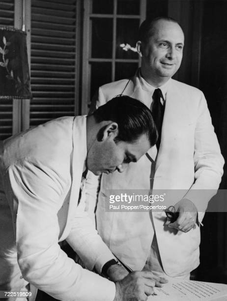 President of Cuba Fulgencio Batista signs the official documents to appoint Ramon Zaydin Prime Minister of Cuba in Havana on 16th August 1942
