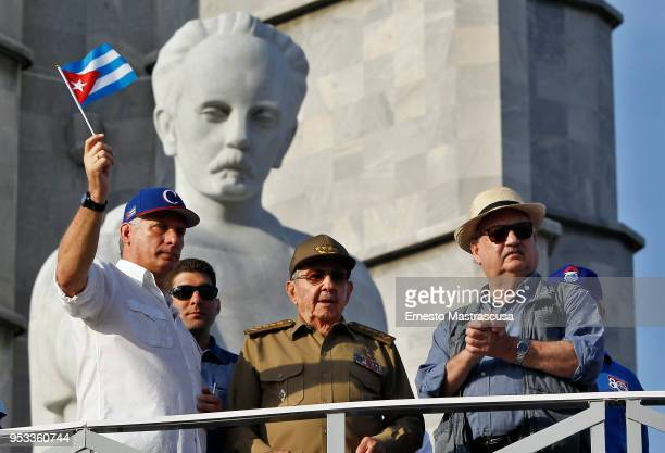 President of Cuba Miguel DíazCanel greets Cubans along with the current first secretary of the Communist Party of Cuba Raúl Castro and president of...