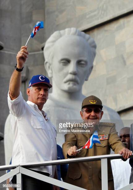 President of Cuba Miguel DíazCanel greets Cubans along with the current first secretary of the Communist Party of Cuba Raúl Castro during a parade in...