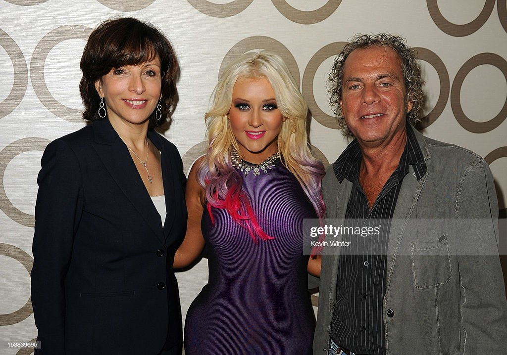 President of Dick Clark Productions Orly Adelson, singer Christina Aguilera, and AMA show produer Larry Klein pose during the 40th Anniversary American Music Awards nominations press conference at the JW Marriott Los Angeles at L.A. LIVE on October 9, 2012 in Los Angeles, California.