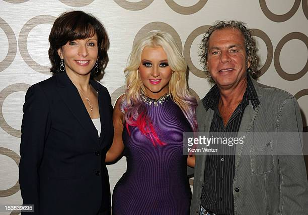 President of Dick Clark Productions Orly Adelson singer Christina Aguilera and AMA show produer Larry Klein pose during the 40th Anniversary American...