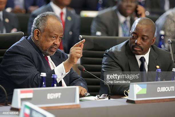 President of Djibouti Ismail Omar Guelleh speaks as President of Democratic Republic of the Congo Joseph Kabila looks on during the first plenary...