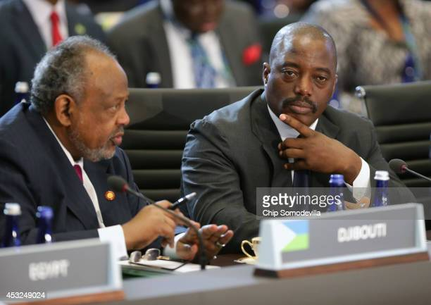 President of Djibouti Ismail Omar Guelleh speaks as President of Democratic Republic of the Congo Joseph Kabila listens during the first plenary...