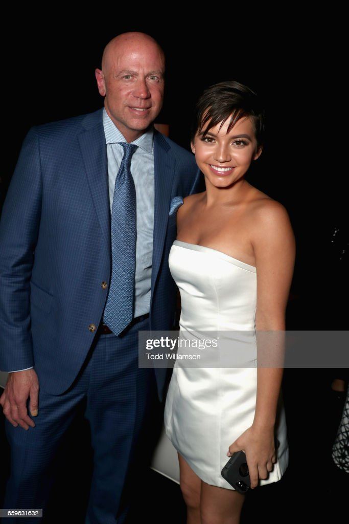 President of Domestic Distribution at Paramount, Kyle Davies (L) and actor Isabela Moner at CinemaCon 2017 Paramount Pictures Presentation Highlighting Its Summer of 2017 and Beyond at The Colosseum at Caesars Palace during CinemaCon, the official convention of the National Association of Theatre Owners, on March 28, 2017 in Las Vegas, Nevada.