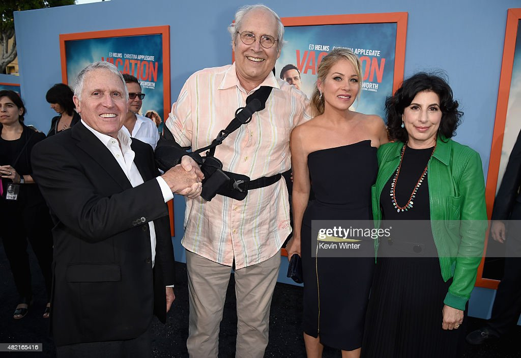 President of Domestic Distribution for Warner Bros. Pictures Dan Fellman, actors Chevy Chase and Christina Applegate with President of Worldwide Marketing and International Distribution at Warner Bros. Pictures Sue Kroll attend the premiere of Warner Bros. Pictures 'Vacation' at Regency Village Theatre on July 27, 2015 in Westwood, California.