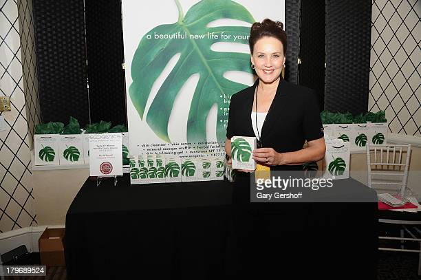 President of Ecogenics Ann McDonnell poses at the GBK Sparkling Resort Fashionable Lounge during MercedesBenz Fashion Week on September 6 2013 in New...