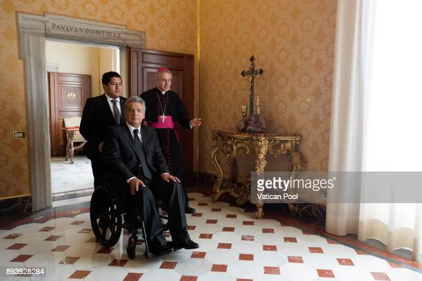 President of Ecuador Lenin Moreno Garces flanked by Prefect of the Pontifical House Georg Ganswein arrives at the Aposolic Palace for a meeting with...