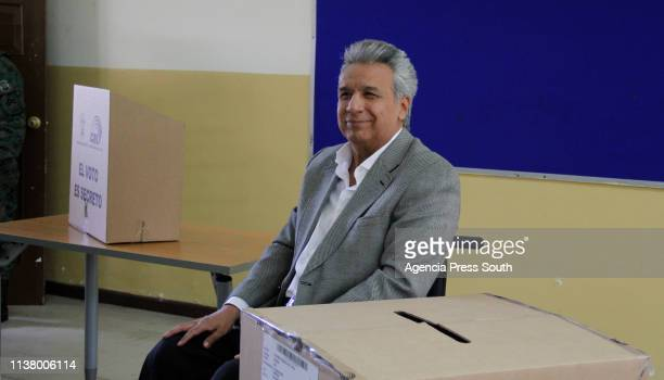 President of Ecuador Lenin Moreno smiles as he casts his vote during the elections for local officials and the seven main members of the Council of...