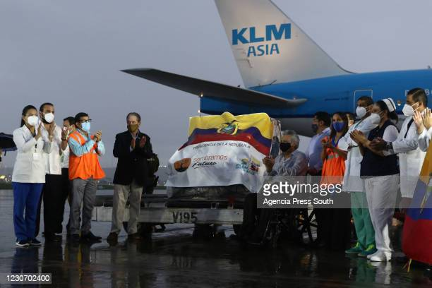 President of Ecuador, Lenín Moreno applauds after receiving the shipment with the first doses of the Pfizer-BioNTech Covid-19 vaccine at Jose Joaquin...