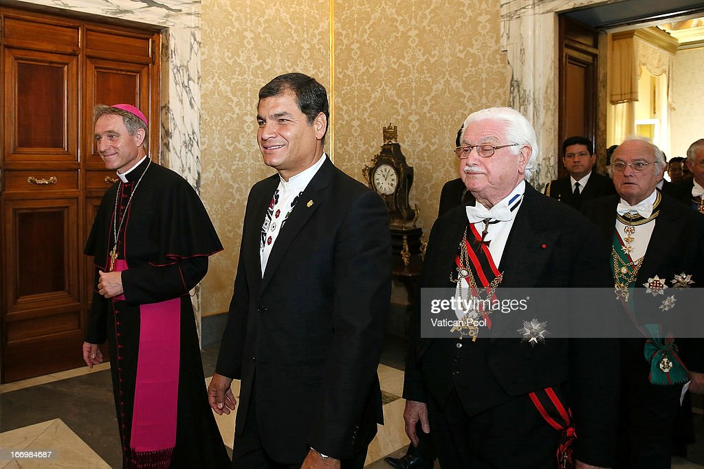 President of Ecuador Rafael Correa flanked by Prefect of the Pontifical House and former personal secretary of Pope Benedict XVI Georg Ganswein as he arrives at the private library of Pope Francis to meet the Pontiff on April 19, 2013 in Vatican City, Vatican. The President of Ecuador met Pope Francis for talks about his country and the church's contribution to aspects of Ecuador's social challenges that lie ahead.