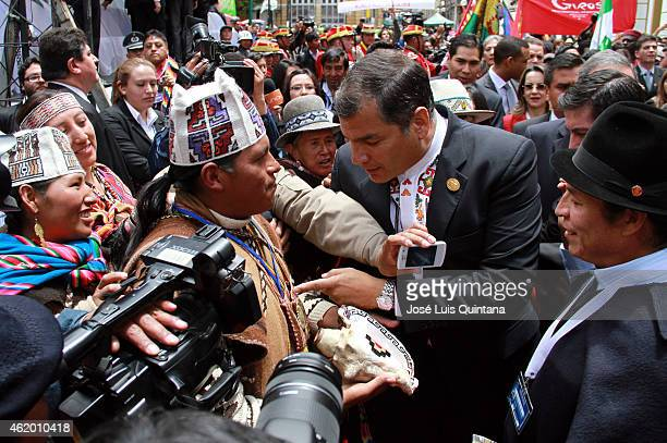 President of Ecuador Rafael Correa greets aymara priests leaving the Plurinational Legislative Assembly after the swearing in ceremony for the third...