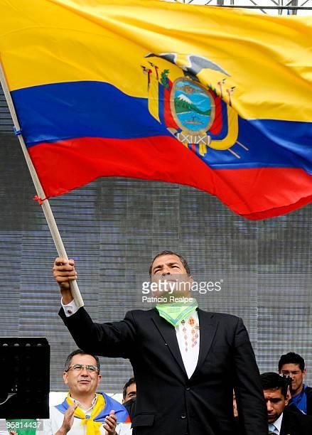 President of Ecuador Rafael Correa raises Ecuadorian flag during a gathering to celebrate three years of government on January 16 2010 in Quito...