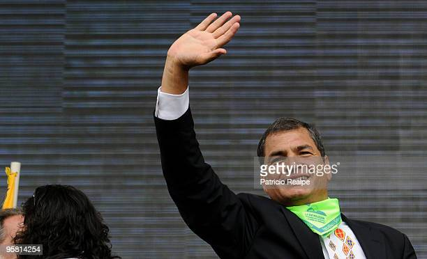 President of Ecuador Rafael Correa waves to population during a gathering to celebrate three years of government on January 16 2010 in Quito Ecuador
