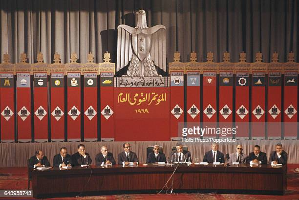 President of Egypt Gamal Abdel Nasser pictured seated 7th from left with Vice President Anwar Sadat seated 5th from left during a meeting of the Arab...