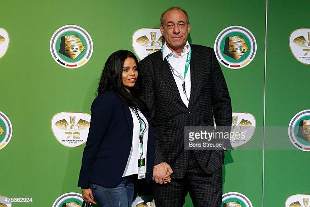 President of Eintracht Frankfurt Peter Fischer and his girlfriend Marci Dudra pose for a photo at the green carpet prior to the DFB Cup Final between...