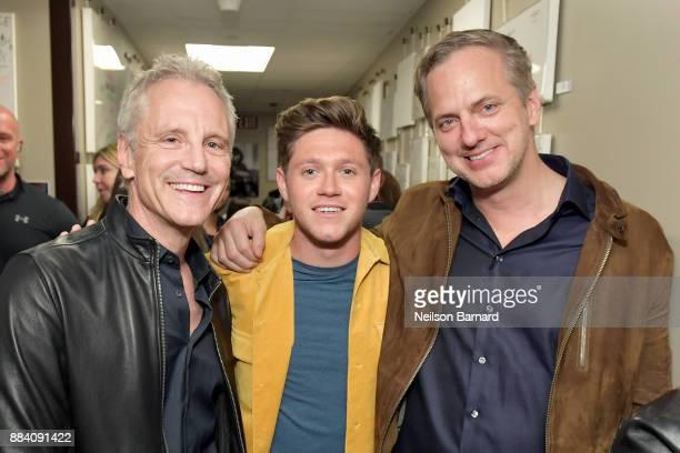 President of Entertainment Enterprises John Sykes Niall Horan and President of National Programming Group for iHeartMedia Tom Poleman attend 1027...