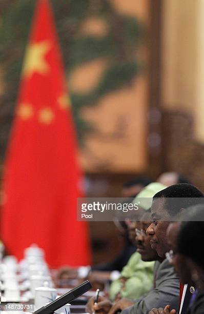 President of Equatorial Guinea Teodoro Obiang Nguema Mbasogo speaks to his Chinese counterpart Hu Jintao during the 5th Ministerial Conference of the...