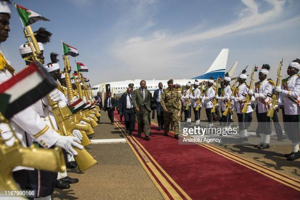 President of Eritrea Isaias Afewerki is welcomed by Abdel Fattah alBurhan chairman of the Transitional Military Council upon his arrival at Khartoum...