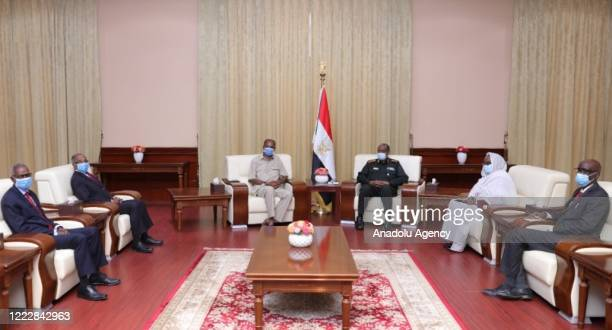 President of Eritrea Isaias Afewerki meets chairman of the Transitional Military Council Abdel Fattah alBurhan during his official visit at...
