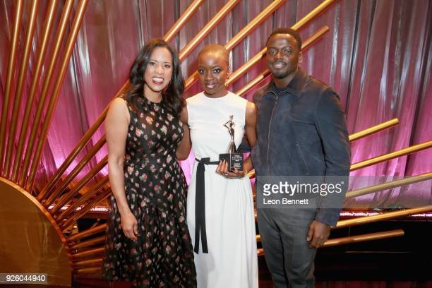 President of Essence Communications Michelle Ebanks Honoree Danai Gurira and Actor Daniel Kaluuya pose onstage during the 2018 Essence Black Women In...