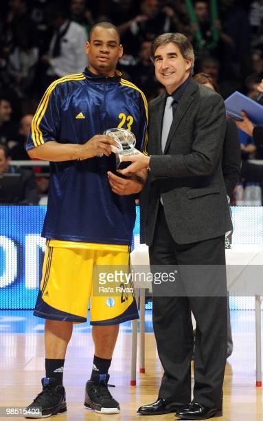 President of Euroleague Jordi Bertomeu presents an award to Immanuel McElroy of Alba Berlin during the Best Season Players Award Ceremony at Fernando...