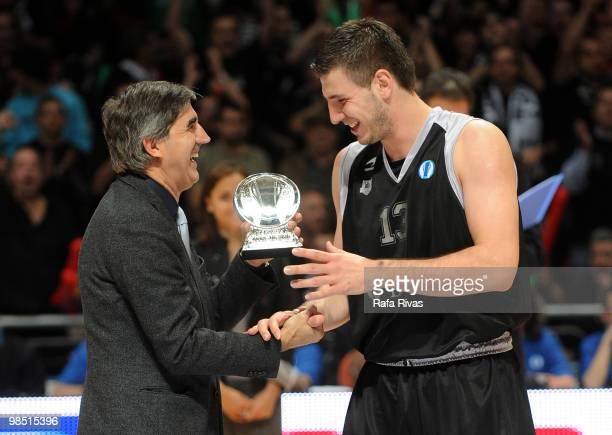 President of Euroleague Jordi Bertomeu presents an award to Marko Banic of Bizkaia Bilbao Basket during the Best Season Players Award Ceremony at...