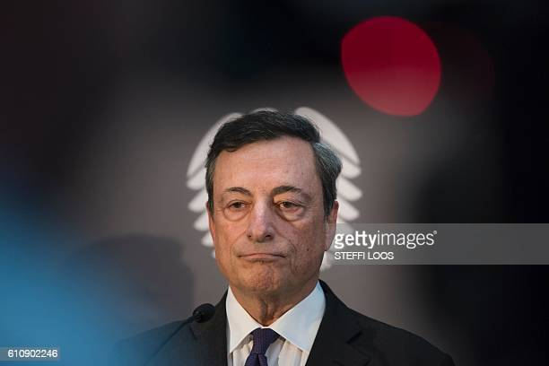TOPSHOT President of European Central Bank Mario Draghi adresses the media after attending a meeting of the Committee on the Affairs of the European...