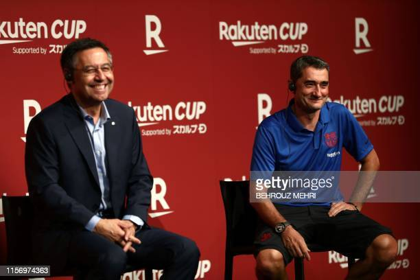 President of FC Barcelona Josep Maria Bartomeu and Barcelona's head football coach Ernesto Valverde attend a reception party in Tokyo on July 21,...