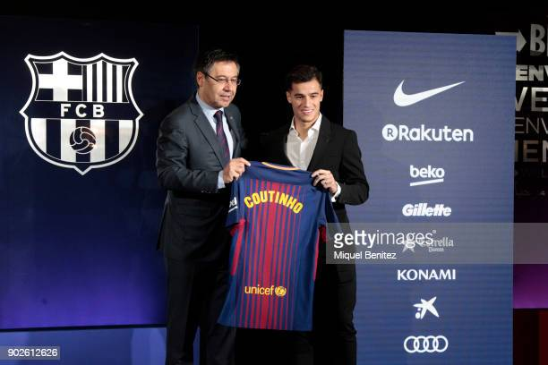 President of FC Barcelona Josep Maria Bartomeu and New Barcelona signing Philippe Coutinho pose to the media at Camp Nou on January 8 2018 in...