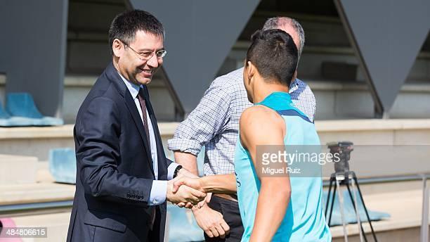 President of FC Barcelona Josep Maria Bartomeu greets Alexis Sanchez during the training session at Ciutat Esportiva on April 14 2014 in Barcelona...