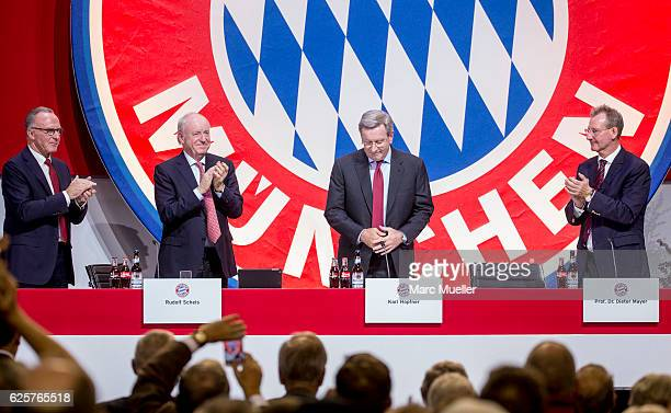 President of FC Bayern Muenchen Karl Hopfner reacts beside Chairman of the board KarlHeinz Rummenigge First Vice President Rudolf Schels and Vice...