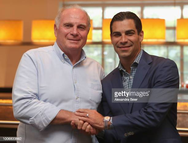 President of FC Bayern Muenchen Uli Hoeness shakes hands with the mayor of the city of Miami Francis Suarez during a cake cutting ceremony...