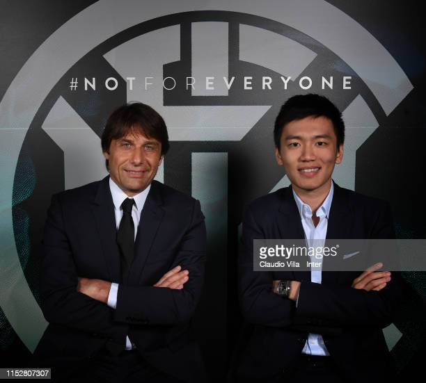 President of FC Internazionale Steven Zhang poses with new head coach Antonio Conte at Appiano Gentile on May 31 2019 in Como Italy