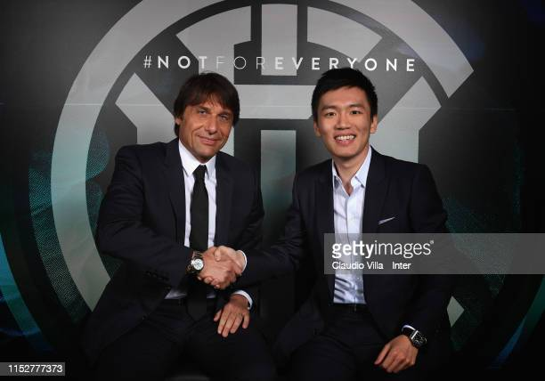 President of FC Internazionale Steven Zhang shakes hands with new head coach Antonio Conte at Appiano Gentile on May 31, 2019 in Como, Italy.