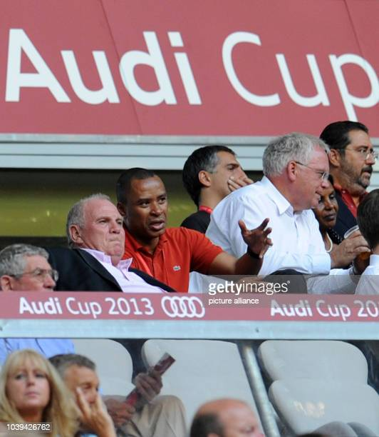 President of FC Bayern Munich Uli Hoeness talks to former soccer player Paulo Sergio of Brazil in the stands during the Audi Cup soccer third place...