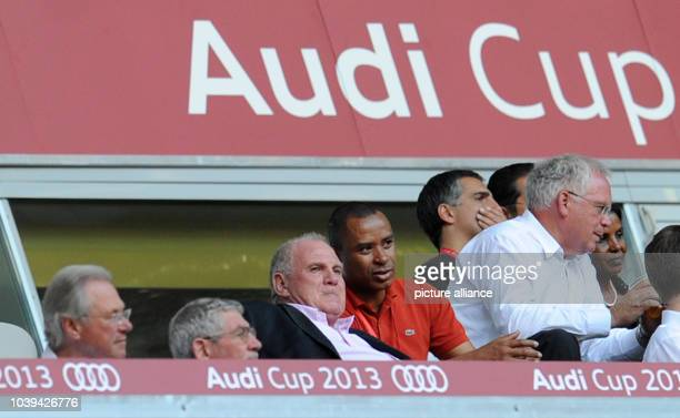 President of FC Bayern Munich Uli Hoeness talks to supporters in the stands during the Audi Cup soccer third place match AC Milan vs FC Sao Paulo at...