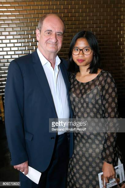 President of 'Festival de Cannes' Pierre Lescure and his daughter Anna attend the Jean Paul Gaultier Haute Couture Fall/Winter 20172018 show as part...