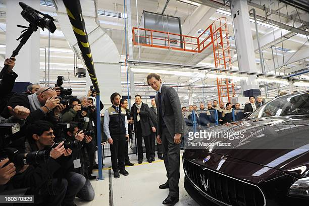 President of FIAT John Elkann poses next to a Maserati Quattroporte during the unveiling of the new Maserati plant in Grugliasco which has been...
