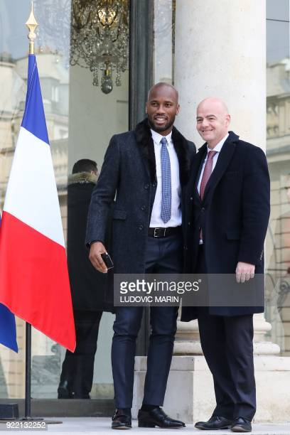President of FIFA Gianni Infantino and Ivory Coast's football player Didier Drogba pose upon their arrival at the Elysee presidential palace for a...